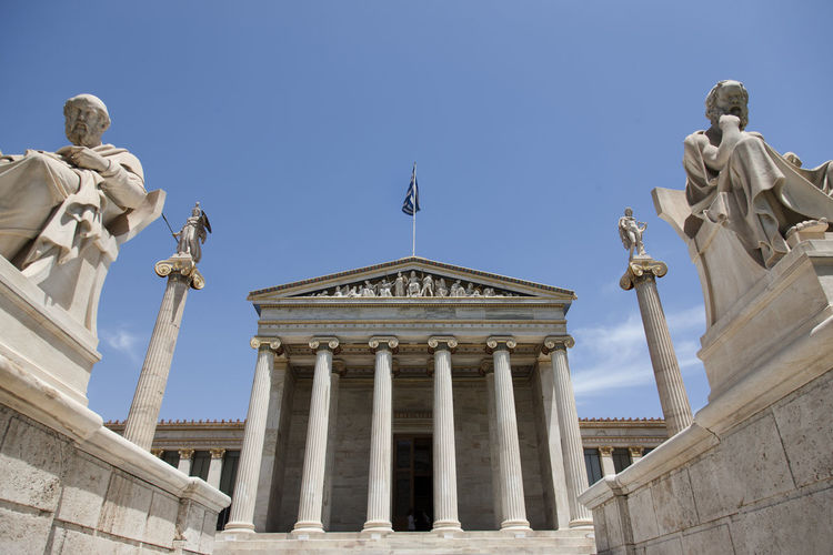 LOW ANGLE VIEW OF Academy Of Athens AGAINST CLEAR SKY
