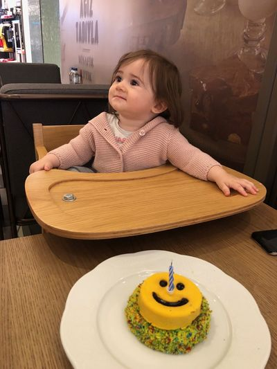 Cute girl sitting on table at cafe