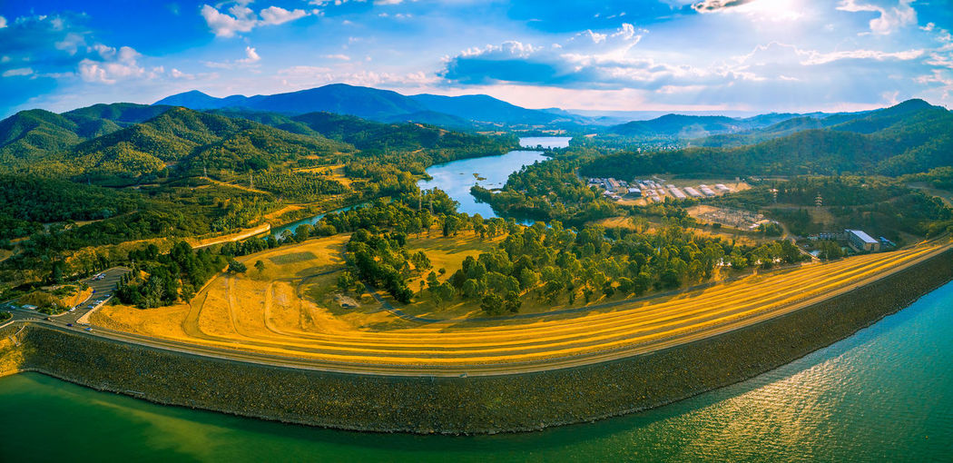 Aerial panorama of Lake Eildon dam and Goulburn River. Melbourne, Victoria, Australia Australia Australian Landscape Beautiful Drone  Panorama Panoramic Recreation  Aerial View Beauty In Nature Cloud - Sky Countryside Day Drone Photography Eildon Eildon Dam Green Color High Angle View Lake Lake Eildon Landscape Mountain Mountain Range Mountain Road Nature No People Outdoors Recreational Pursuit Rural Scene Scenics Sky Tranquil Scene Tree Winding Road