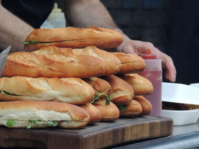 Close-up of fresh baguette pile on cutting board