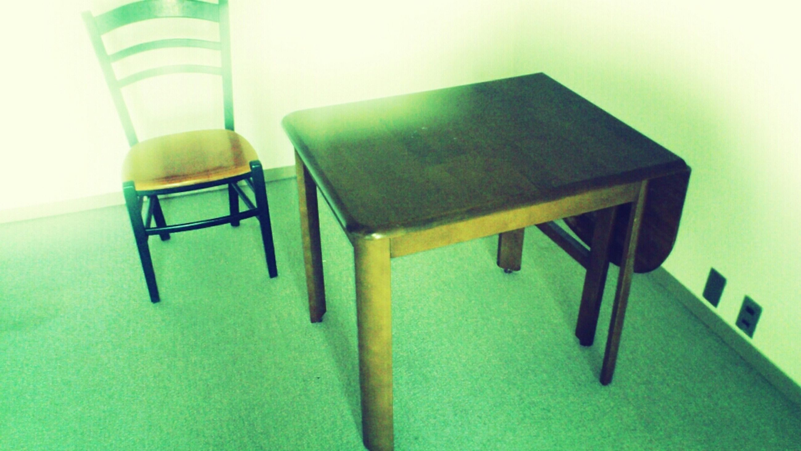 indoors, empty, absence, chair, table, still life, home interior, wall - building feature, furniture, no people, wall, seat, arrangement, in a row, shadow, group of objects, close-up, hanging, day, domestic room