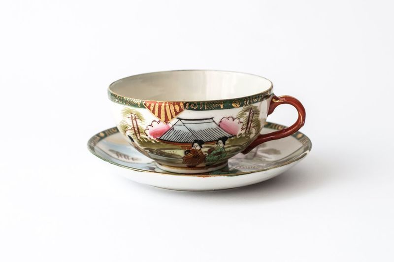 Close-up of tea cup against white background