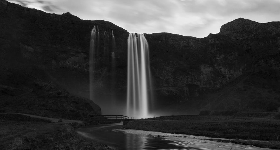 Black And White Bridge Day Iceland Idyllic Landscape Long Exposure Motion Mountain Nature No People Outdoors River Scenics Seljalandsfoss Sky Travel Destinations Water Waterfall Lost In The Landscape Black And White Friday
