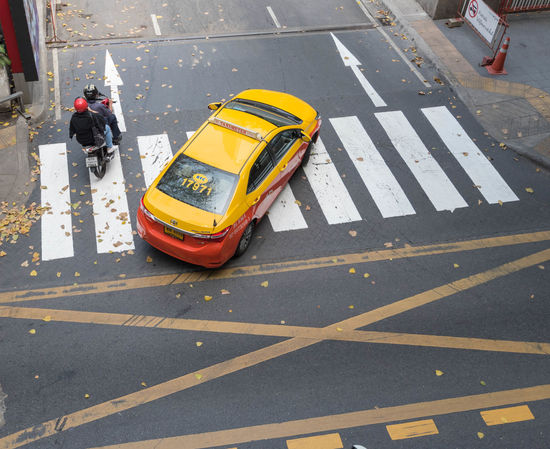 Taxi Traffic City Cross Walk Day High Angle View Men Motorcycles One Person Outdoors Overhead View People Real People Reflective Clothing Street Transportation