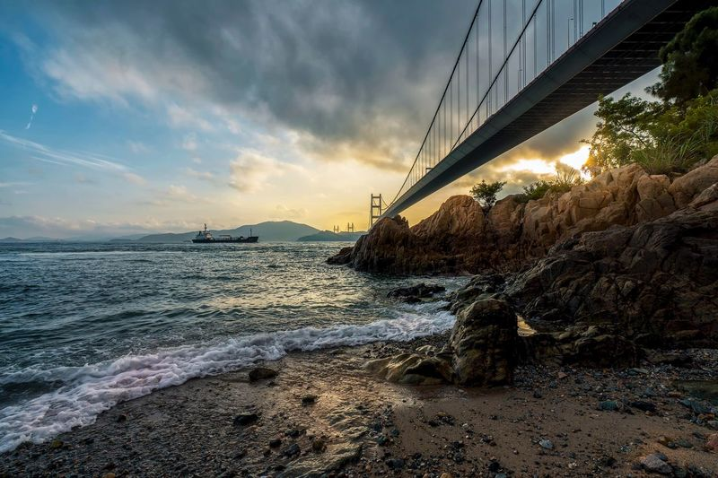 under the bridge ---by Sony alpha7 mark II Sky Sea Cloud - Sky Sunset Water No People Outdoors Nature Architecture Travel Destinations Built Structure Beach Bridge - Man Made Structure Scenics Beauty In Nature Horizon Over Water EyeEmNewHere Mix Yourself A Good Time The Week On EyeEm Beauty In Nature Travel China Nature Sea Backgrounds