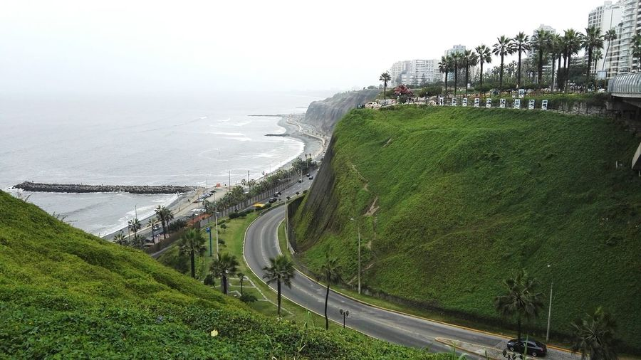 Lima-Perú Water Sea Road Grass Green Color Transportation Tranquil Scene High Angle View Tranquility Landscape Tree Scenics Clear Sky Day Ocean Nature Remote Beauty In Nature Coastline Outdoors