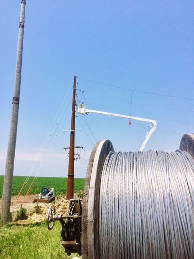 Day Clear Sky Outdoors Cable Transportation Fuel And Power Generation Nature Water Blue Sky Grass Green Color Close-up Agriculture Landscape Field Electricity  Power Line  Electricity Pylon