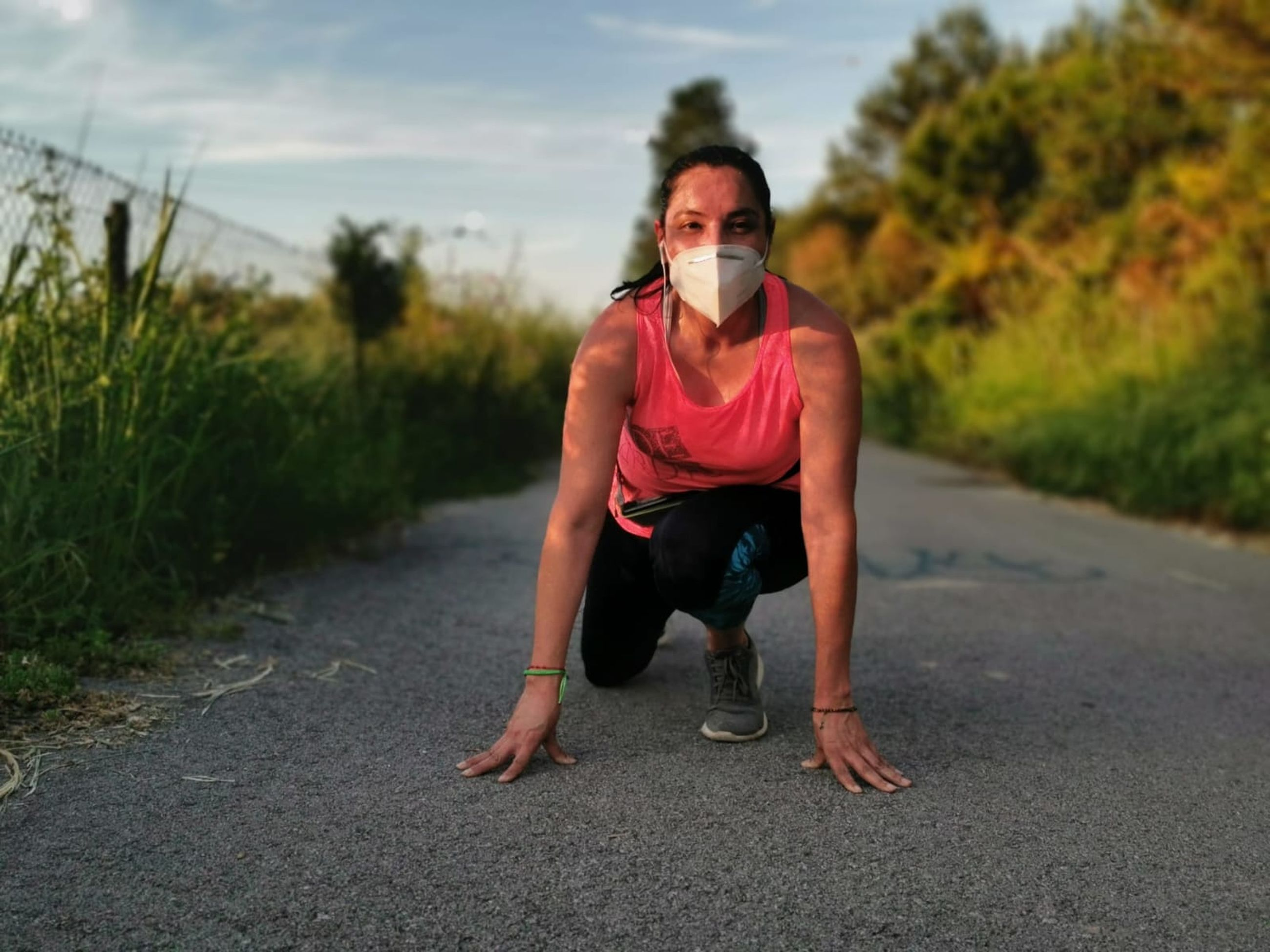 exercising, adult, one person, sports, lifestyles, sports clothing, sports training, road, full length, clothing, nature, front view, athlete, wellbeing, leisure activity, vitality, muscular build, jogging, activity, day, sky, determination, person, running, outdoors, strength, women, portrait, endurance, young adult, city, athleticism, transportation, plant, relaxation, recreation, motivation
