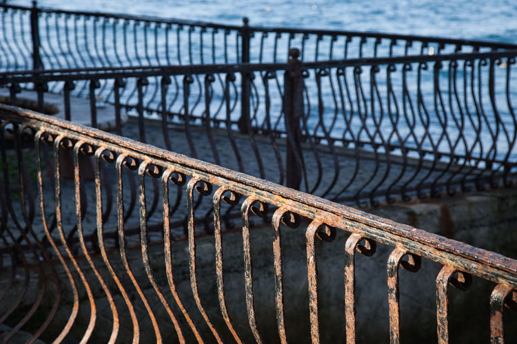 Close-up of pier on bridge over river
