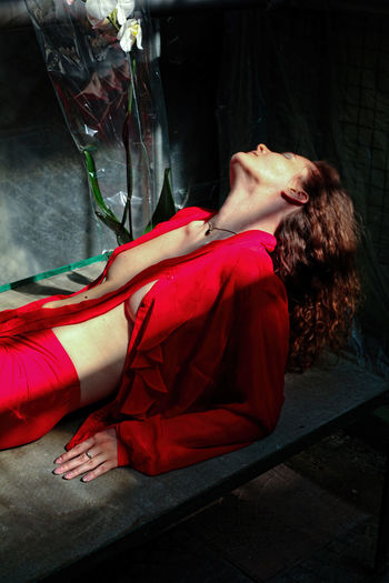 Midsection of woman lying down on floor