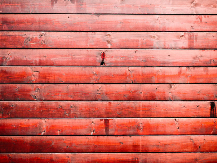 Full frame shot of red wooden plank