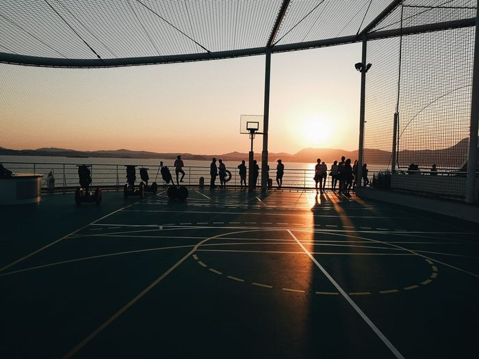 Competition Crowd Group Of People Large Group Of People Leisure Activity Lifestyles Men Nature Orange Color Outdoors Real People Sea Silhouette Sky Sport Sun Sunset Transportation Water HUAWEI Photo Award: After Dark