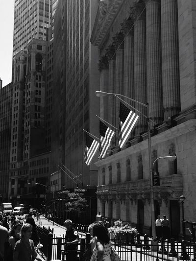 Wallstreet Building Exterior Financial District  Stockexchange Commerce Makingmoney Officer Crowd Blackandwhite Photography NYC American Flags