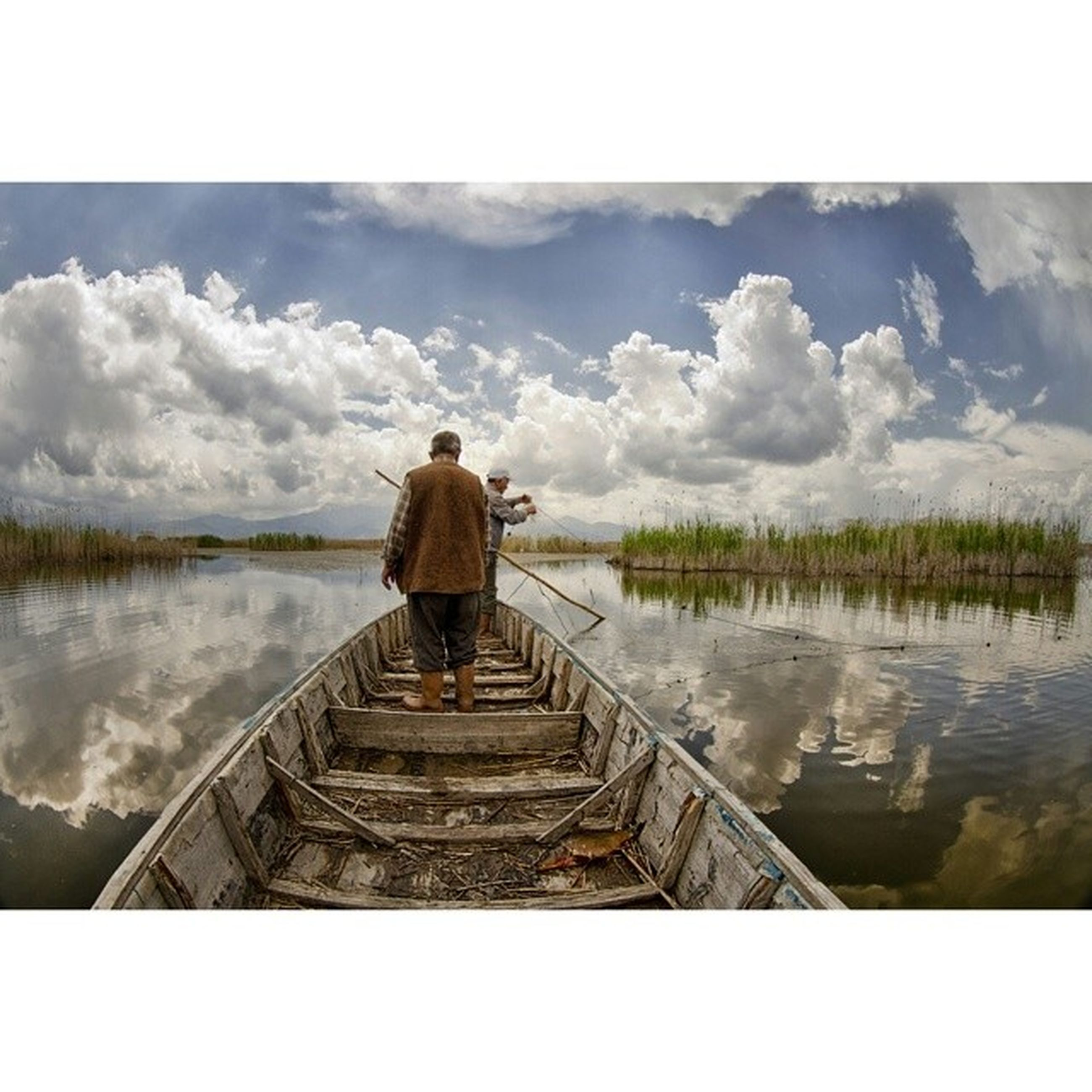 water, rear view, lifestyles, pier, sky, full length, leisure activity, standing, lake, railing, the way forward, men, tranquility, cloud - sky, jetty, tranquil scene, nature, person