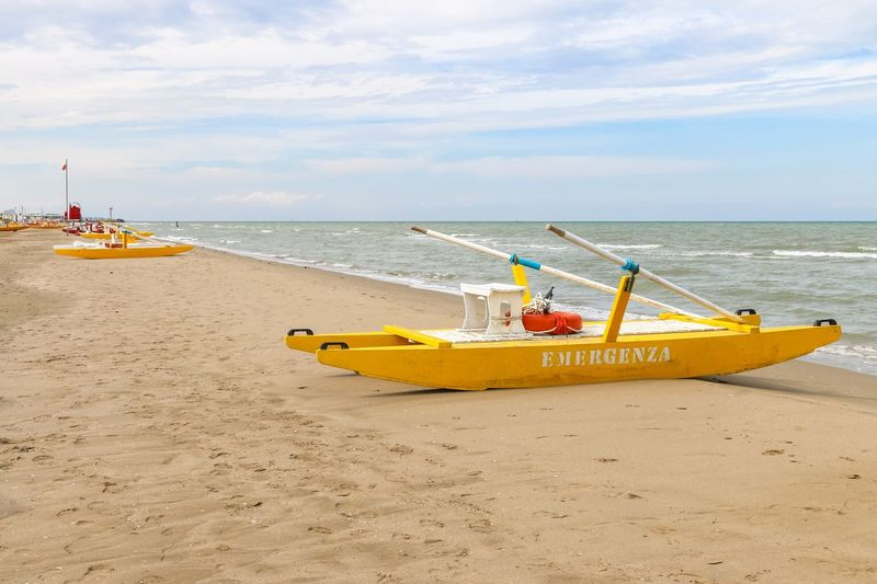 Emergenza boat at the beach, Italy, Riccione Italy. Riccione Italy Emiliaromagna Rimini Riccione Resort Vacation Boat Emergency Vehicle Rescue Boat Water Sea Sky Horizon Over Water Nautical Vessel Cloud - Sky Transportation Shore Sand Mode Of Transport Beach Day No People Yellow Outdoors Tranquility Scenics
