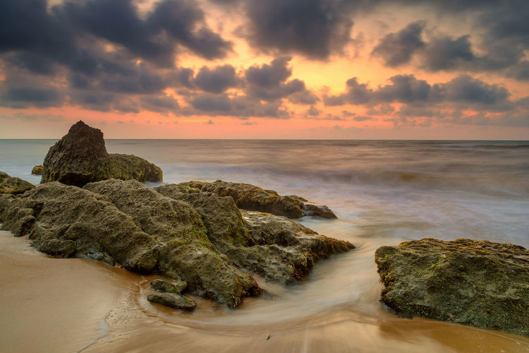 Beach Beautiful Nature Colorful Sky And Clouds Motion Blur Nature No People Orange Sky Outdoors Rocky Beach Sarawak Scenics Sea Seascapes Slow Shutter Sunlight Sunset Waves Streaming Seascape Coastline Coast Rocky Coastline