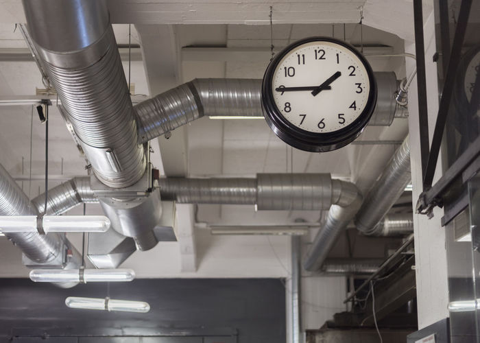 Low angle view of clock in workshop
