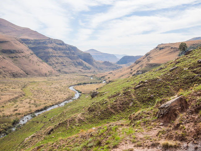 Creek Drakensberg, South Africa Drakensburg Mountains, South Africa, Mountain Hiking Beauty In Nature Day Drakensberg Grass Landscape Mountain Mountain Range Mountain Road Nature No People Outdoors River Road Scenics Sky Tranquil Scene Tranquility Water