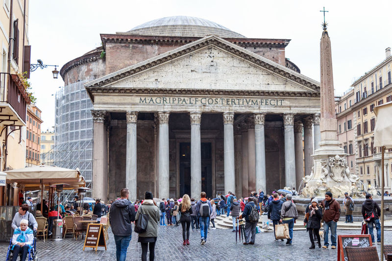 tourists near the building of the Pantheon in Rome City Historic Downtown Pantheon Roma Tourist Attraction  Travel Trip Ancient Civilization Architectural Column Architecture Building Exterior Built Structure History Italy Large Group Of People Leisure Activity Lifestyles Monument Of Architecture People Real People Tourism Travel Travel Destinations Trip Photo Walking Moving Around Rome Adventures In The City