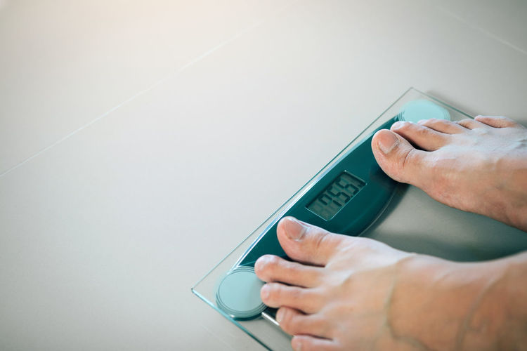 Scale  Weight Measure Loss BMI Anorexia Woman Feet Supplement Male Pound Training Foot Machine Lose Fat Fit People Body Health Frustrated Concept Skinny Slim Food Problem Anorexic Mass Diet Plan Standing Overweight Fitness Lifestyle Check Calories person Balance Legs