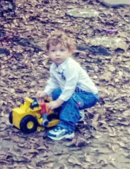Our young man playing in the yard
