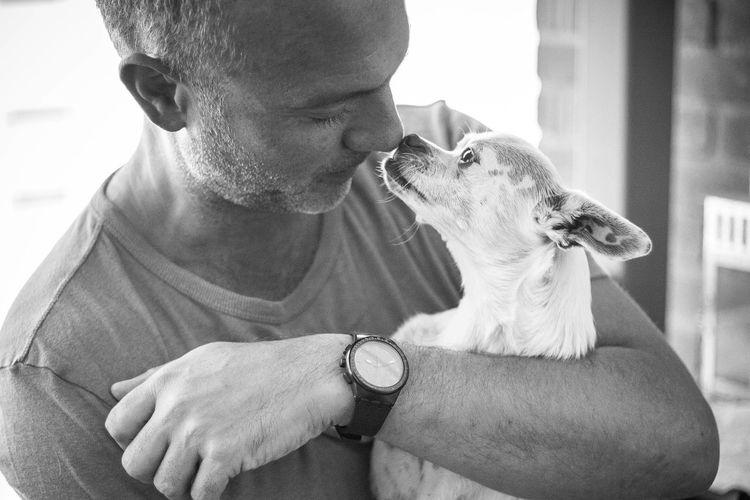 Man Embracing Dog