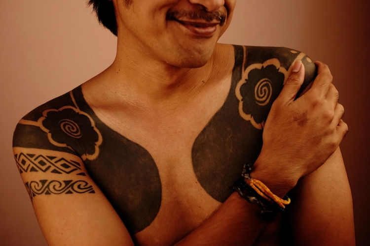 embrace ur fear Asian  Portraits Adult Bracelet Chest Embracing Emotion Fashion Flower Tattoo Front View Happiness Human Body Part Indoors  Lifestyles Mature Adult Men Midsection One Person Portrait Real People Shirtless Smile Smiling Tattoo Young Adult First Eyeem Photo EyeEmNewHere