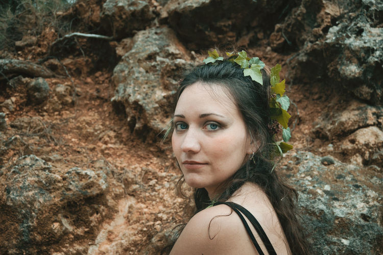 Portrait of young woman on rock