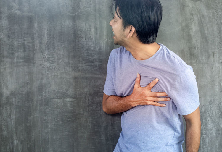 Midsection of man standing at home
