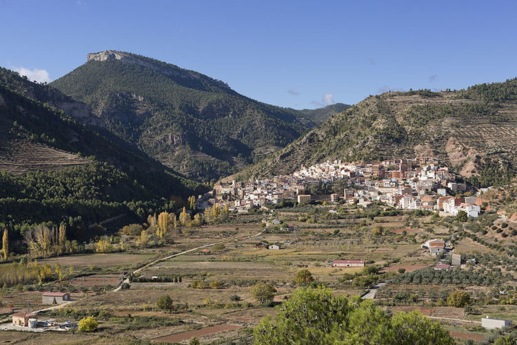 General view of the town of Bogarra in the province of Albacete, Spain Albacete Bogarra SPAIN Agriculture Architecture Beauty In Nature Building Exterior Built Structure Clear Sky Day Landscape Mountain Mountain Range Nature No People Outdoors Rural Scene Scenics Sky Town Tranquil Scene Tranquility Tree