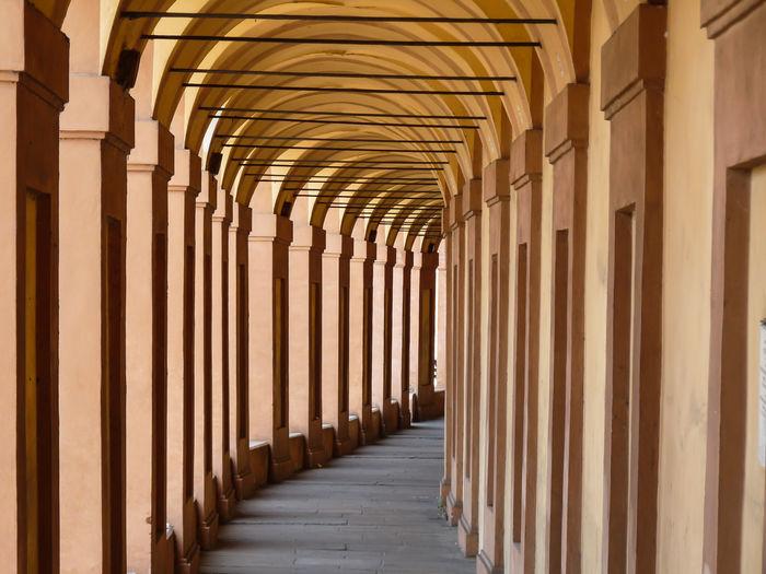 Empty corridor along pillars