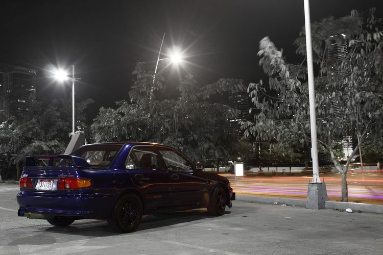 Automotive photoshoot this ocassion Lancer EvolutionII Land Vehicle Car Mode Of Transport Road Parking Street Parked Stationary Vehicle No People Outdoors Panama City PanamaCity Panama507 Night Photography Nightphotography Panamá Panama At Nigth Place LancerEvo EvolutionII RallyArt Evolution  Automotive Photography Automotive