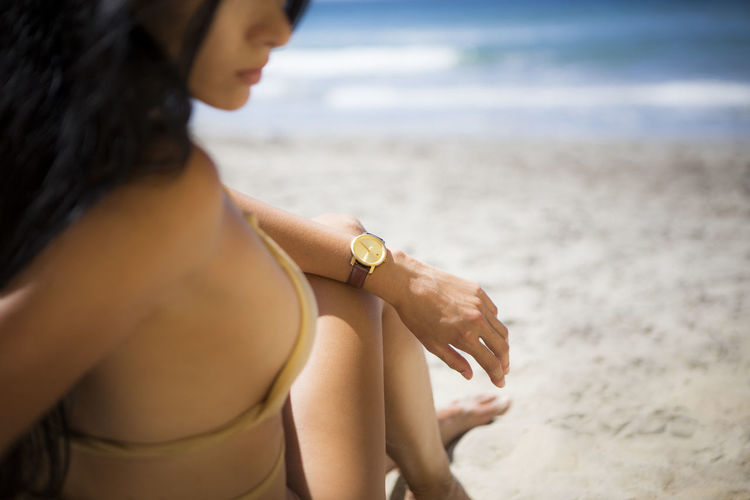 Young woman at the beach in Southern California. Barefoot Beach Carefree Contemplation Happiness Human Hand Human Leg Leisure Activity Ocean Real People San Diego Sand Woman Women