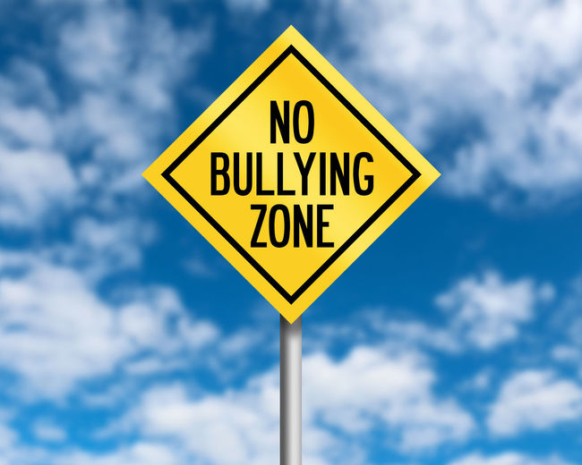 Blue Bully Bullying Classroom Cloud - Sky Communication Day Focus On Foreground Geometric Shape Information Low Angle View Nature No Bullying No People Outdoors Road Road Sign Shape Sign Sky Sunlight Text Warning Sign Warning Symbol Yellow