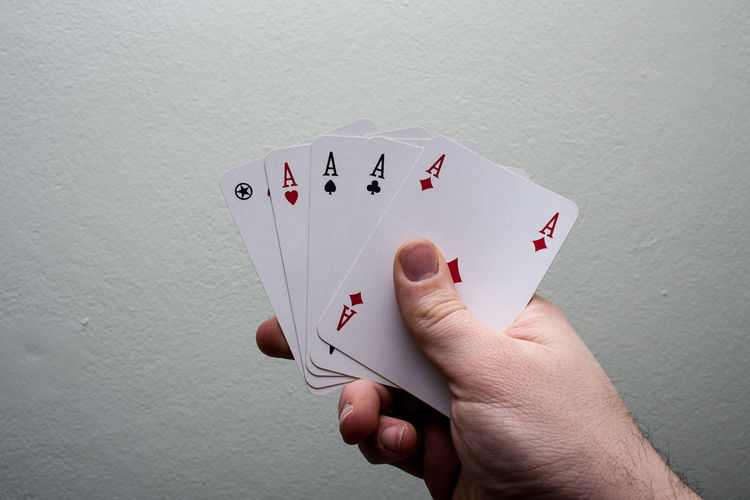 Casino Adult Cards Chance Close-up Day Fanned Out Gambling Human Body Part Human Finger Human Hand Indoors  Leisure Activity Leisure Games Luck One Person People Playing Poker - Card Game Poker Cards Pokercards RISK Showing Table Winning