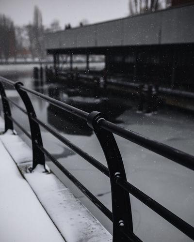 Snow on railing during rainy season