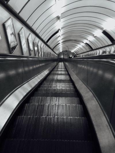 High Angle View Of Escalators Leading Towards Subway