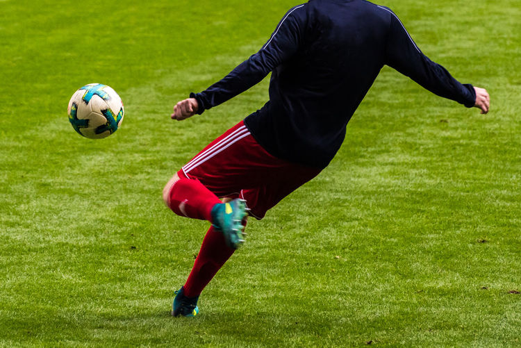 Man playing soccer on field