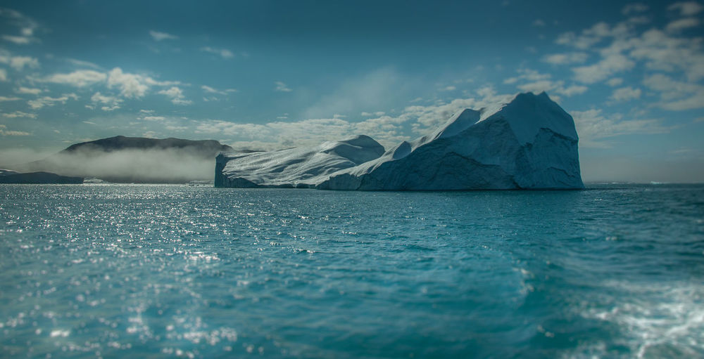 Arctic Beauty In Nature Cloud - Sky Cold Temperature Day Greenland Ice Iceberg Nature No People Outdoors Scenics Sea Sky Water