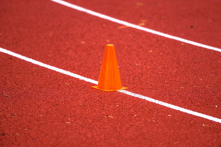 Traffic cone on running track
