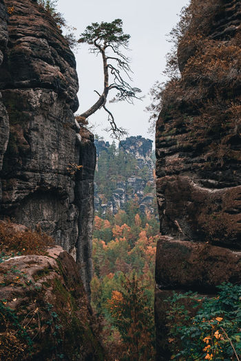 Rock formation on mountain against sky