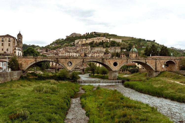 Built Structure Architecture Bridge Bridge - Man Made Structure Arch Arch Bridge Connection Nature Sky Plant Grass Transportation Water Day The Past History No People Building Exterior Tree Outdoors Arched Ancient Civilization Cosenza Cosenzacentrostorico Sud Italia Suditalia Old Old-fashioned Old Ruin Old Buildings Old Town Oldcity Old City Italy Italia Italy❤️ Italy🇮🇹 Beauty In Nature Beauty Beautiful Architecture Architecture_collection Architectural Feature