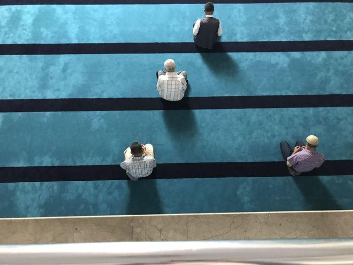 Directly above shot of men praying