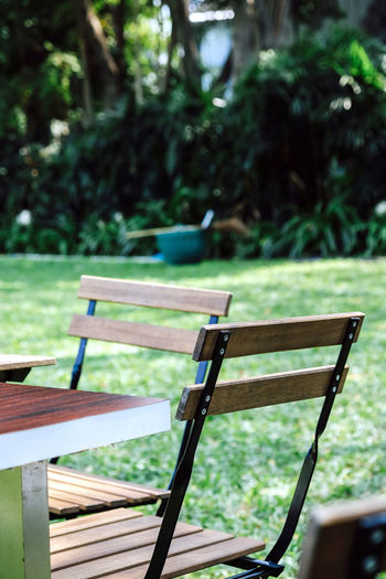Empty bench and table in park