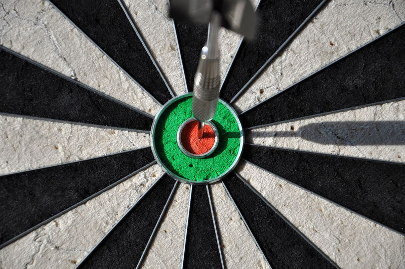 Close-up of dart on bulls-eye