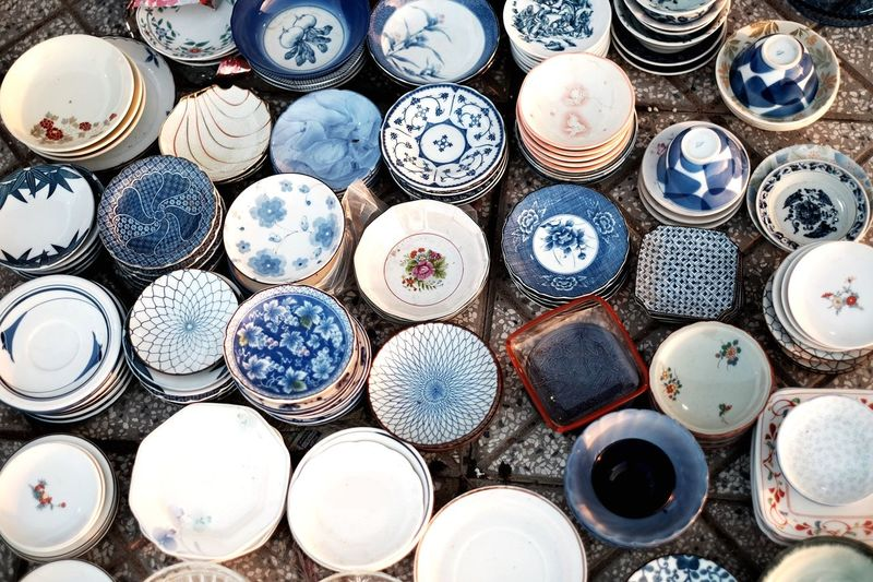High angle view of crockeries for sale at market stall