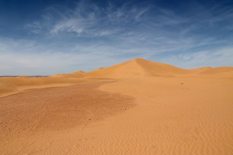 Scenic View Of Sahara Desert Against Blue Sky