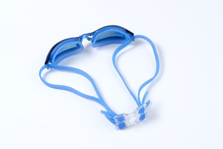 Blue Clean Equipment Glossy Goggle Goggles Rubber Swim Swimming Swimming Goggle White White Background Studio Shot Indoors  Cut Out Still Life Close-up No People Copy Space Single Object High Angle View White Color Shape Directly Above Design Two Objects Simplicity Heart Shape Group Of Objects Three Objects Silver Colored