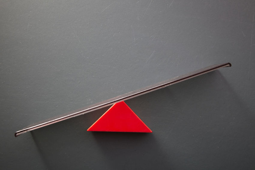 pivot point concept of balancing Copy Space Force Pivotal Ideas Balance Blackboard  Co-existence Concept Counter Balance Down Equilibrium Fulcrum Geometric Shape Imbalance Movement No People Pivot Rating Seesaw Still Life Studio Shot Swing Triangle Shape Up Weight Weighting