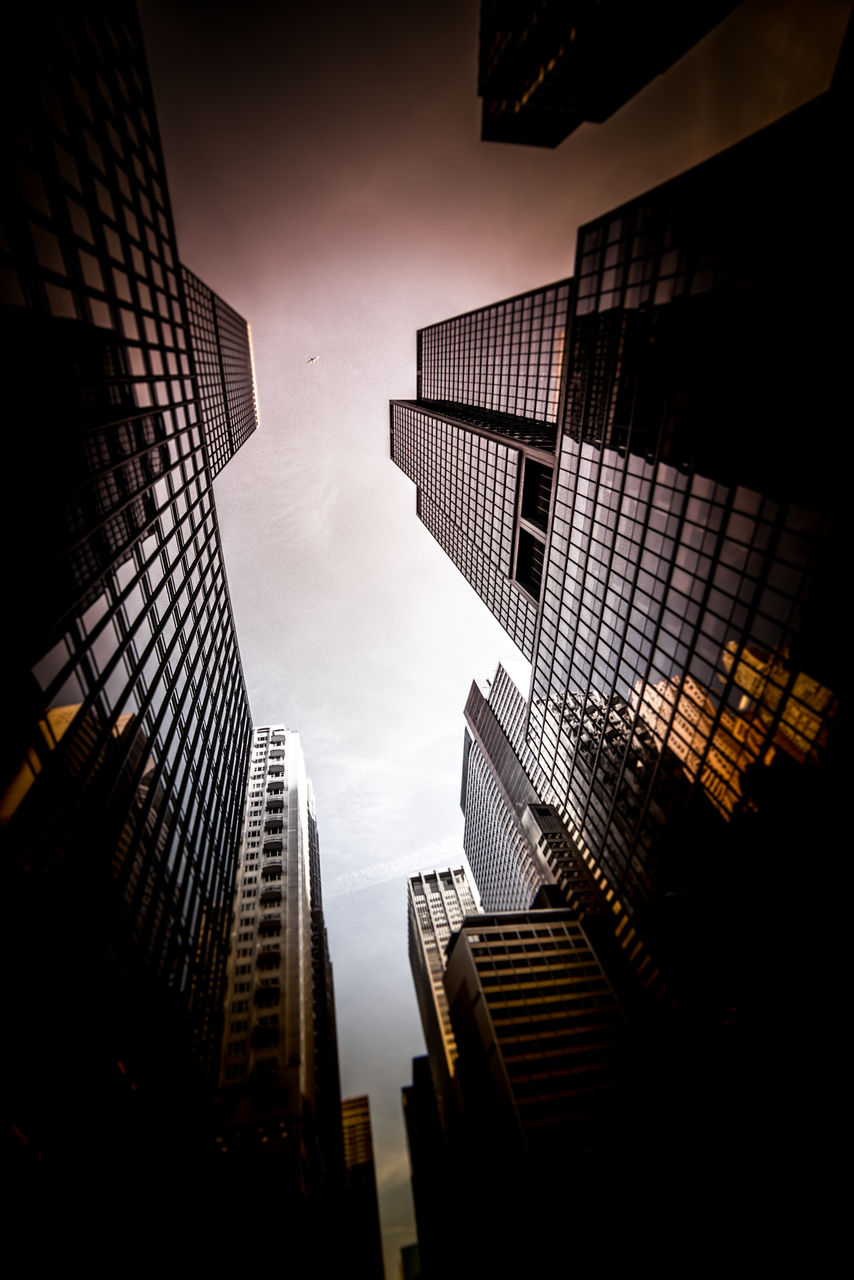 built structure, building exterior, architecture, building, low angle view, city, office building exterior, sky, tall - high, office, modern, no people, skyscraper, tower, nature, outdoors, city life, dusk, cloud - sky, sunset, financial district, directly below